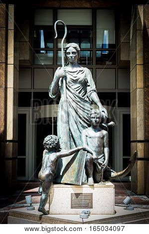 CAPE TOWN SOUTH AFRICA - 19 DECEMBER 2016: Waterfront BOE Statue of Shepherdess and Cupids outside Nedbank Building - Cape Town - South Africa - Original commissioned by BoE in 1894; copy by the Bronze Age Art Foundry Simonstown