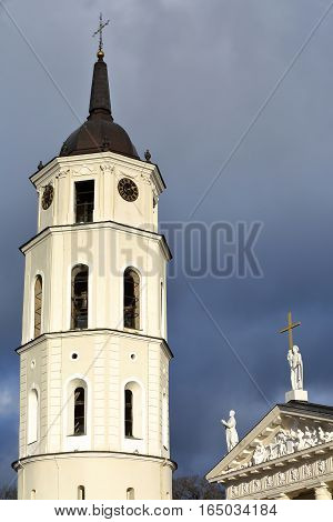 VILNIUS, LITHUANIA - JANUARY 3, 2017: The Belfry (Cathedral Clock Tower) and the  Cathedral on Cathedral Square with a stormy sky