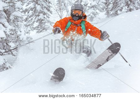 Closeup photo of skier skiing in forest. Off-piste speed concept