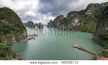 Ha Long Bay, Vietnam - December 02, 2015: View of Halong Bay, Hang Sung Sot cave harbour. View of the limestone islands in the background