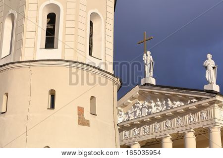 VILNIUS, LITHUANIA: The Belfry (Cathedral Clock Tower) and the  Cathedral on Cathedral Square with a stormy sky