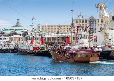 CAPE TOWN SOUTH AFRICA - DECEMBER 19 2016: Photo of The Jolly Roger Pirate ship entering the Victoria and Alfred Waterfront harbour in Cape Town during December holidays