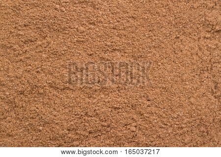 texture of ground spices cinnamon light brown