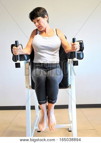 Mature female beauty working out inside a healthclub.