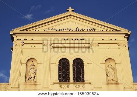 birds on the Cathedral facade Tarquinia Italy