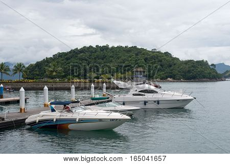 Mangaratiba Brazil - january 05 2017: Boats stopped at the pier in Angra dos Reis bay