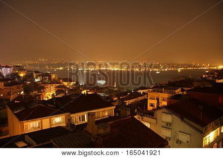 Cloudy city scape at night on the Bosphorus, Turkey