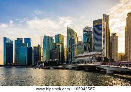 Singapore - January 07 2017: Singapore Cityscape Financial building with Dramatic Cloud in Marina Bay area Singapore Golden Hour Urban Dusk