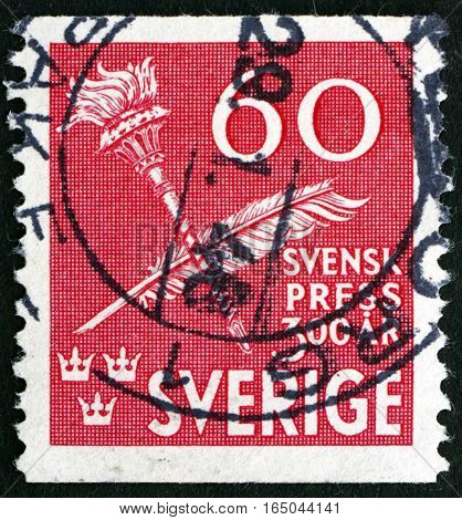SWEDEN - CIRCA 1945: a stamp printed in Sweden shows Torch and Quill Pen Tercentenary of Swedish Press circa 1945