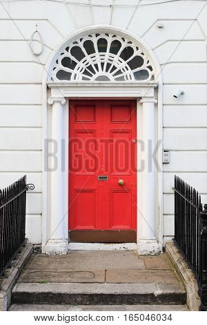 Red door on a townhouse in Dublin Ireland