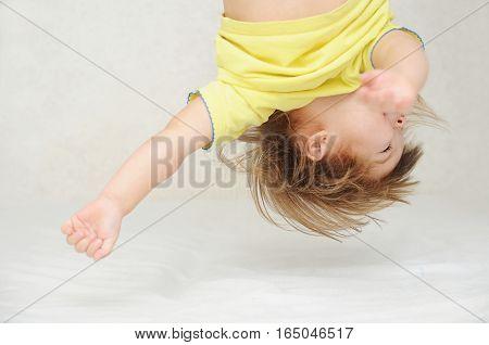 Happy Funny Little Girl  Upside Down Head Having Fun