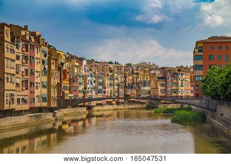 A river view of local houses in Girona, Spain
