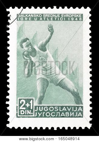 YUGOSLAVIA - CIRCA 1948 : Cancelled postage stamp printed by Yugoslavia, that shows Shot put.
