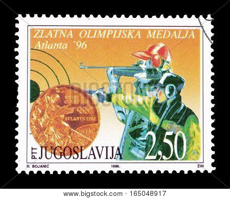 YUGOSLAVIA - CIRCA 1996 : Cancelled postage stamp printed by Yugoslavia, that shows Shooting.