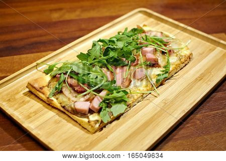 Focaccia with jamon peper cream and cheese.