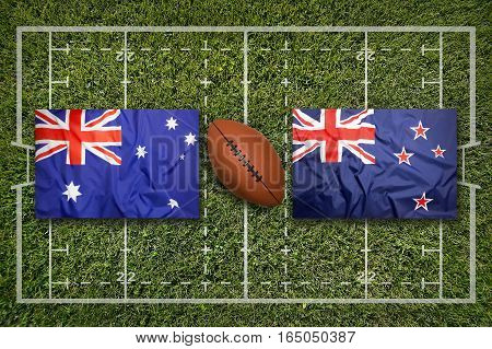 Australia vs. New Zealand flags on green rugby field, 3d illustration