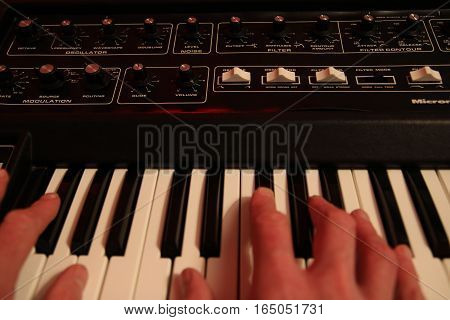 Man's Hands Playing A Vintage Retro Analogue Synth