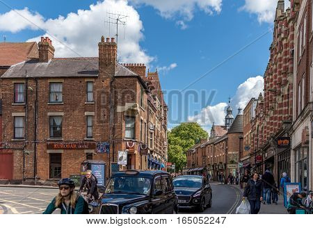 Oxford, UK - April 30, 2016: People at George Street shopping and enjoying a sunny day at Oxford
