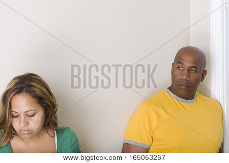 Multicultural couple arguing and having relationship problems.