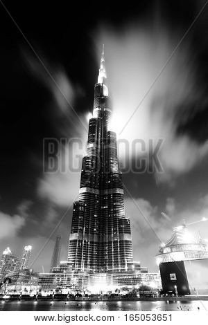 DUBAI UAE - MARCH 28: The Burj Khalifa tallest building in the world taken on March 28 2015 in Dubai. In front is The Dubai Fountain show the biggest fountain in the world.