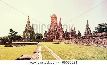 Vintage style Wat Chaiwatthanaram is ancient buddhist temple famous and major tourist attraction religious of Ayutthaya Historical Park in Phra Nakhon Si Ayutthaya Province Thailand 16:9 widescreen