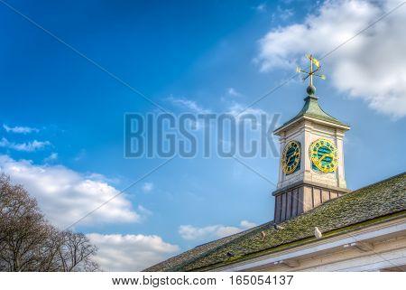 Weather Vane And Clock
