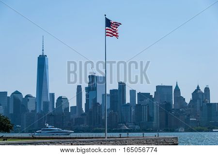American flag with Manhattan skyline in the ackground