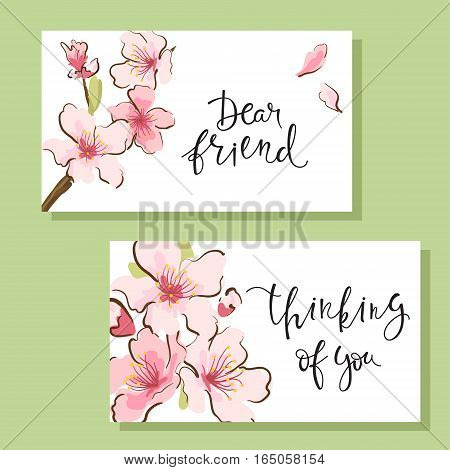 Set of flyers or greeting cards with cherry blossom design and hand-written inscription. Gentle trendy design. Vector illustration.