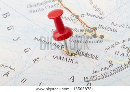 Close up of Kingston Jamaica map with red push pin.