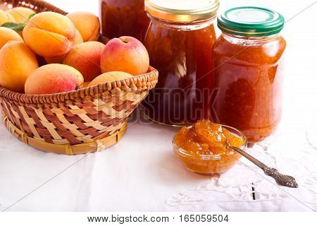 Apricot jam in small bowl and jars