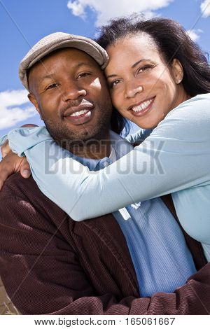 Portrait of an African American couple smiling.