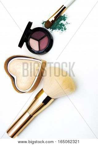 Makeup highlighter, make-up on Valentine's Day, shadow and brushes for make-up, make-up artist for the tools.