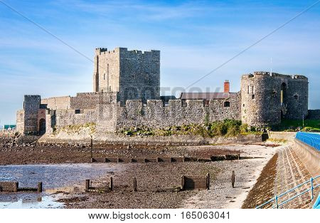 Medieval Norman Castle in Carrickfergus near Belfast, Northern Ireland, during a low tide