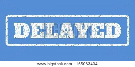 White rubber seal stamp with Delayed text. Vector tag inside rounded rectangular frame. Grunge design and unclean texture for watermark labels. Horisontal sign on a blue background.