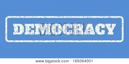 White rubber seal stamp with Democracy text. Vector tag inside rounded rectangular shape. Grunge design and dirty texture for watermark labels. Horisontal sticker on a blue background.