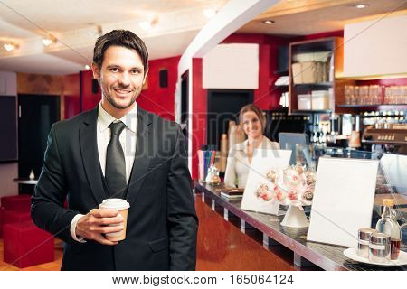 businessman getting his early-morning coffee at a cafe