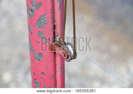 The rusty iron pulley with blue sky background