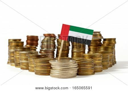 United Arab Emirates Flag Waving With Stack Of Money Coins