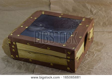 wooden box handmade background crumpled paper. wooden box upholstered with leather.
