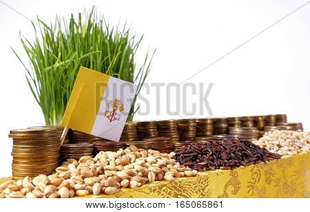 Vatican City Flag Waving With Stack Of Money Coins And Piles Of Wheat And Rice Seeds