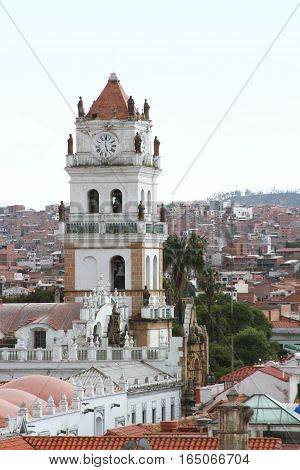 Sucre Bolivia - December 7 2016: Clock tower of Metropolitan Cathedral with view of Sucre Bolivia on December 7 2016