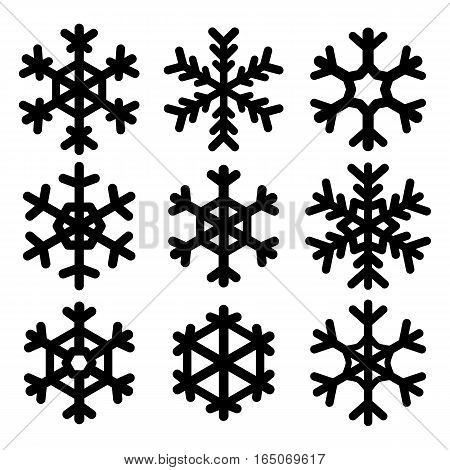 Set of vector black snowflakes. Isolated silhouettes on white background