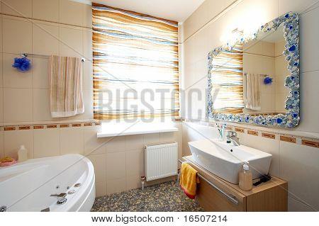 Beautiful mirror and washstand in a modern bathroom