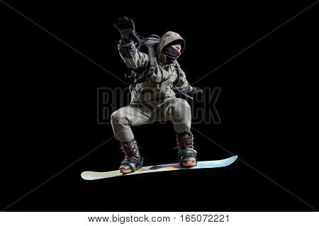 snowboarder in the air isolated on black background