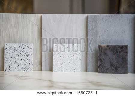 a solid marble texture background of three square samples