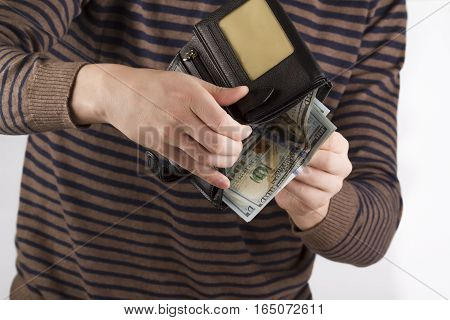 purse with money in the hands of men spend money