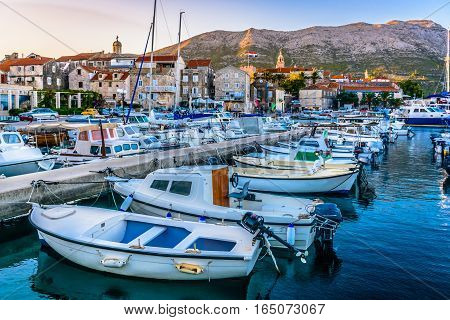 Sunset view at marina and promenade in Korcula town, croatian travel places.