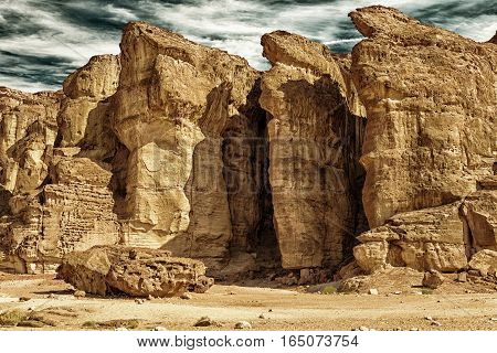 The Famous Solomons Pillars - Geological attraction in Timna Park near to Eilat Israel. The first copper mines in the history and the Hathor temple were here. (HDR image black gold filter)