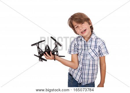 A Cheerful boy playing with a drone.
