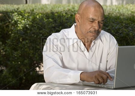 African American senior citizen with laptop computer